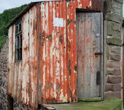 Old fisherman& x27;s hut at St. Abbs harbour. Rusty old tin fisherman& x27;s hut at St. Abbs harbour Stock Images