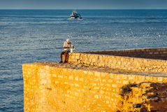 Old Fisherman on the Sea Stock Photography