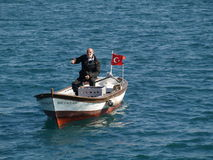 Old fisherman. Turkish old fisherman on a boat near the Galatasaray Stock Photography