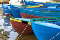 Old fishermans boats on water Stock Image