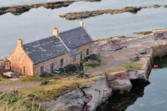 Old Fishermans cottages near a small harbour. Stock Images