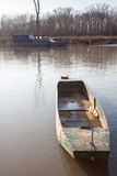 Old fishermans metal boat on the river Stock Photos