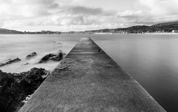 Departure gate in the beach. Old fishermans pier at south end of Praia America, Nigrán, Galicia Spain. Long exposure daylight shot 20mm f/10 16.0 secs ISO100 Royalty Free Stock Images