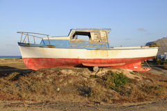 Old fishermen boat abandoned on shore Stock Images