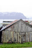 Old Fishermen Log Cabin, Bike and Harbor Stock Photos