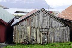 Old Fishermen Log Cabin, Bike and Harbor stock photo