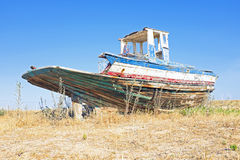Old fishers boat in Portugal. Old desolated fishers boat in Portugal Royalty Free Stock Photo