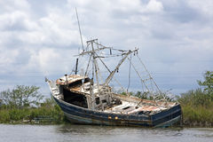 An old fishing boat. Old fishing boat, damaged by the hurricane Katrina. New Orleans, Louisiana Royalty Free Stock Photography