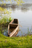 Old fishing boat. From the river bank Stock Image