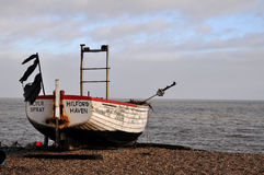 Old fishing boat. On a shingle bank by the sea Stock Photo