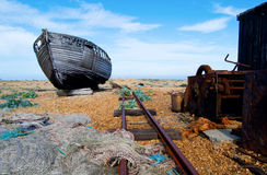 Old fishing boat. An abandoned old fishing boat surrounded by nets, rope and a railway line Royalty Free Stock Image