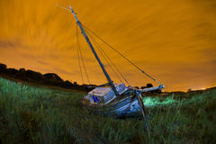 Old fishing boat. On the side of the dee estury, england Stock Image