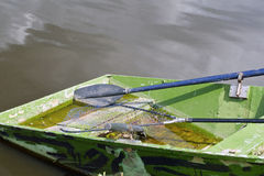 Old fishing boat. A old fishing boat in a lake, Russia Royalty Free Stock Image