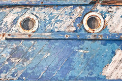Old fishing boat. Close up of the portholes on the side of an old fishing boat Stock Image