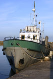 Old fishing boat. A picture of the front of an old fishing boat, docked at the jetty Stock Image