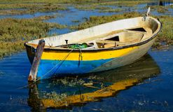 Old fishing boat. Abandoned old fishing boat in calm water in comporta, alentejo Portugal Royalty Free Stock Photography