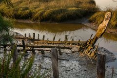 Old fishing boat. Abandoned old fishing boat lying near the mud in comporta, alentejo Portugal Stock Image