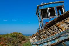 Old fishing boat. Abandoned old fishing boat lying near the water in comporta, alentejo Portugal Royalty Free Stock Image