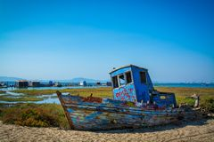 Old fishing boat. Abandoned old fishing boat lying on sand in comporta, alentejo Portugal Royalty Free Stock Images