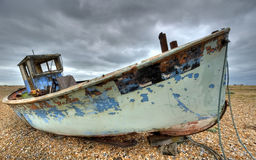Old fishing boat abondond and rotting. Old fishing boat abandoned dungerness uk beach Stock Images