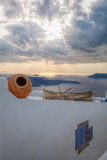 Old fishing boat against sunset on Santorini island in Greece Stock Image