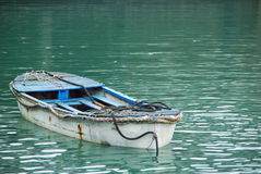 Old fishing boat. Anchored on a tranquil water surface Royalty Free Stock Photography