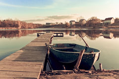 Old fishing boat ashore lake Royalty Free Stock Photos
