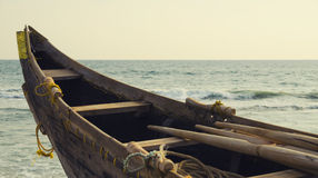 Old fishing boat. On background of ocean waves Royalty Free Stock Photos