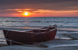 Old fishing boat at the Baltic sea, Kurzeme, Latvia. The old fishing boat at sunrise on sandy beach of the Baltic Sea, Latvia, Europe stock images