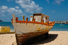 Old Fishing Boat on Beach Stock Images