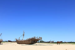 The old fishing boat. An old fishing boat on the beach stock photos