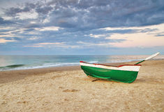Old fishing boat. On beach of the Baltic Sea Stock Photos