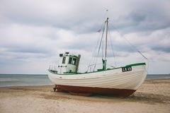 Old fishing boat on the beach royalty free stock photography