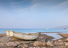 Old fishing boat at the beach of the Red sea, Israel Stock Image