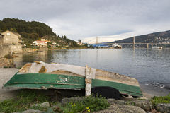 Old fishing boat beached in the Vigo estuary stock images