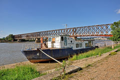 Old fishing boat and bridge behind Royalty Free Stock Images