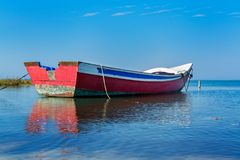 Old fishing boat. In calm water on comporta, alentejo Portugal Royalty Free Stock Photo