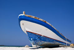 Old fishing boat on a Caribbean beach. An old weathered fishing boat on a Caribbean beach Royalty Free Stock Images