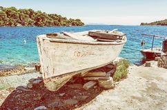 Old fishing boat with cracked white paint, Solta, yellow filter Royalty Free Stock Photo