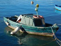 Old fishing boat on the dock. Old fishing boat on a dock of a harbour of the Mediterranean sea royalty free stock photo
