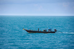 Old fishing boat goes by sea - fishermen working Stock Photos