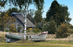 Old fishing boat on the grass, Latvia Royalty Free Stock Image