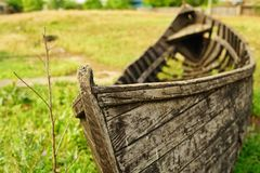 Old fishing boat in the grass stock photo