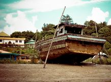 Old fishing boat that have been abandoned at Malaysian beach royalty free stock images