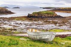 Old fishing boat on Icelandic shore. Royalty Free Stock Images