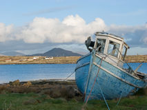 Old fishing boat in Ireland. Old fishing boat in Roundstone, Connemara, Ireland Royalty Free Stock Images