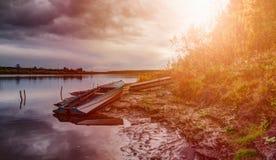 Old fishing boat on lake coast. Royalty Free Stock Photo