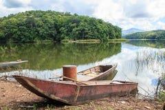 Old fishing boat on lake shore Stock Photography