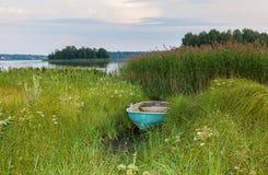 Old fishing boat at the lake Stock Photo