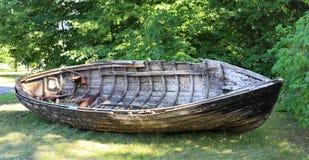Old fishing boat lying on the shore, Latvia Royalty Free Stock Photo